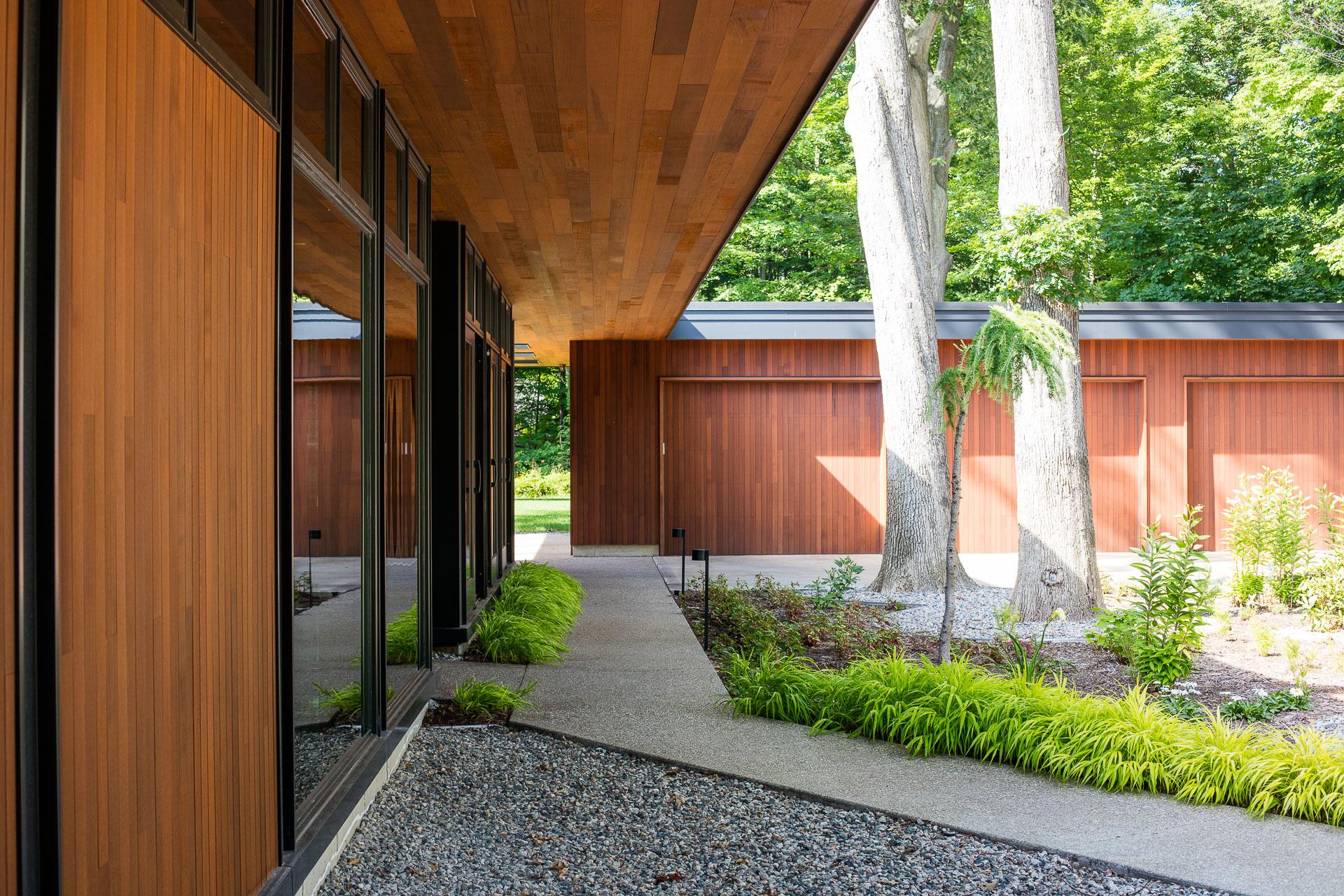 saugatuck mid century modern home plan design warm large roof overhang west michigan